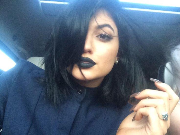 black lipstick and black manicure